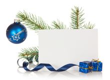 Fir-tree branch with Christmas toy and blank card Royalty Free Stock Images