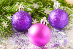 Fir tree branch and Christmas toys bauble with confetti Royalty Free Stock Photos