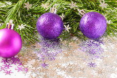 Fir tree branch and Christmas toys bauble with confetti Royalty Free Stock Image