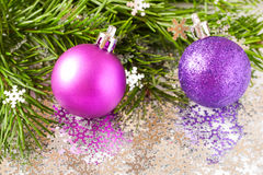 Fir tree branch and Christmas toys bauble with confetti Stock Photos