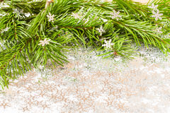 Fir tree branch and Christmas toys bauble with confetti Royalty Free Stock Photo