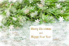 Fir tree branch and Christmas toys bauble with confetti Royalty Free Stock Photography