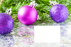 Fir tree branch and Christmas toys bauble with confetti Royalty Free Stock Images