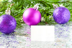 Fir tree branch and Christmas toys bauble with confetti Stock Image