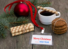 Fir-tree branch, coffee, oatmeal cookies and label Christmas Stock Photography