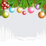 Fir tree branch with cones and christmas balls on grey background with white forest Stock Image