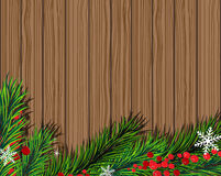 Fir tree branch  with red berries. Christmas fir tree and red berries on wooden board Royalty Free Stock Image