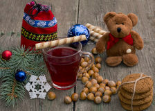 Fir-tree branch, tea, bear, baking, bag and nuts, on a wooden ta Royalty Free Stock Photos