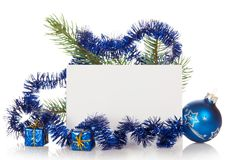 Fir-tree branch with tinsel, small gift boxes and Royalty Free Stock Photo