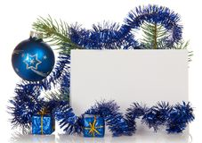 Fir-tree branch with tinsel, small gift boxes, Stock Image