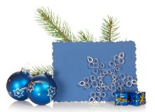 Fir-tree branch, two bright Christmas toys, small Royalty Free Stock Images