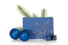 The fir-tree branch, two Christmas toys, gift Royalty Free Stock Photography