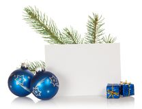 The fir-tree branch, two Christmas toys, small Royalty Free Stock Photo