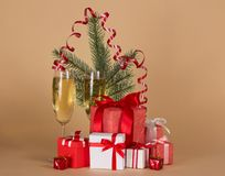 Fir-tree branch, wine glasses with champagne Royalty Free Stock Image