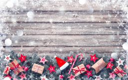 Fir tree branches with advent calendar stars and gift boxes royalty free stock photo
