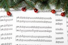 Free Fir Tree Branches And Red Balls On Christmas Music Sheets With Notes, Flat Lay Royalty Free Stock Photography - 200372487