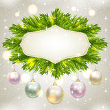 Fir-tree branches and baubles. Christmas card with fir-tree branches and baubles Royalty Free Stock Photo