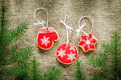 Fir tree branches Christmas gingerbread biscuits on bagging back Stock Photos