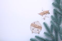 Fir tree branches with christmas toys on a white background stock image