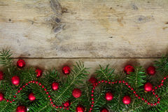 Fir tree branches decorated with red christmas balls as border o Stock Photography