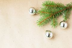 Fir tree branches decorated with silver christmas balls as border on a rustic holiday background frame with copy space.  stock photo