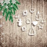 Fir tree branches and hanging toys on the wooden board background. Christmas vector illustration Royalty Free Stock Image