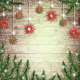Fir tree branches and hanging toys on the wooden board background. Royalty Free Stock Photography