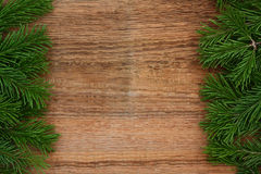 Fir-tree branches on old wooden background Stock Image