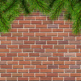 Fir tree branches on red briсk wall. Christmas background with fir tree branches on a red brick wall, vector illustration Stock Photos