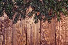 Fir tree branches on rustic wooden background. Christmas holiday