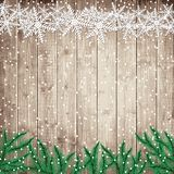 Fir tree branches and snowflakes on the wooden board. Stock Photography