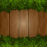 Fir tree branches on a wooden background. Christmas background with decorative spruce branches on a wooden boards, illustration Stock Photo
