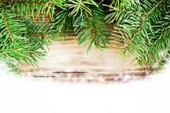 Fir Tree Branches on Wooden Board with Snow Stock Image