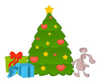 fir-tree with bunny and boxes Royalty Free Stock Photography