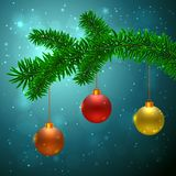 Fir tree with 3 Christmas balls. Red, yellow and orange on dark blue background with bokeh effect Stock Images