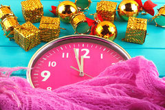 Fir tree with christmas decorations, alarm clock and gift Royalty Free Stock Photos