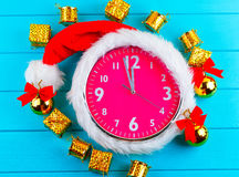 Fir tree with christmas decorations, alarm clock and gift Stock Photography