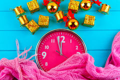 Fir tree with christmas decorations, alarm clock and gift Royalty Free Stock Image