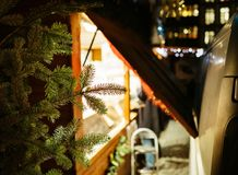 Fir tree and Christmas market preparation with open market stall Royalty Free Stock Photography