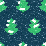 Fir tree covered with snow seamless pattern. Stock vector illustration on winter season theme in green, white, dark blue colors Stock Photography