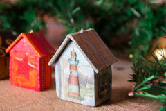 Fir tree decoration: handmade Christmas houses with ornaments Stock Images