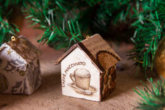 Fir tree decoration: handmade Christmas houses with ornaments Royalty Free Stock Image