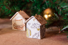 Fir tree decoration: handmade Christmas houses with ornaments Royalty Free Stock Images