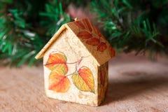 Fir tree decoration: handmade Christmas houses with ornaments Stock Photo