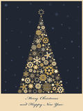 Fir tree from golden snowflakes Stock Photos