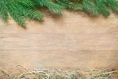 Fir tree and hay christmas abstract background on wooden board royalty free stock photography