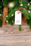 Fir  tree with merry christmas tag for 24 december Royalty Free Stock Photo