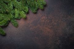 Fir tree pine cones and decorations on dark stone table. Christmas background. Fir tree with pine cones on dark stone table. Top view with copy space Royalty Free Stock Image
