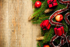 Fir tree with pinecones, apples and decorations Royalty Free Stock Photos