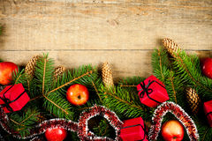 Fir tree with pinecones, apples and decorations Royalty Free Stock Images